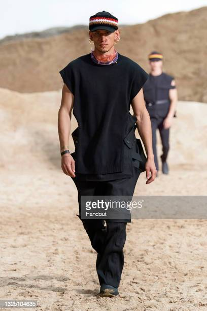 In this handout image provided by Burberry, a model walks the runway during the Burberry Spring/Summer 2021 Menswear Presentation on June 23, 2021 in...