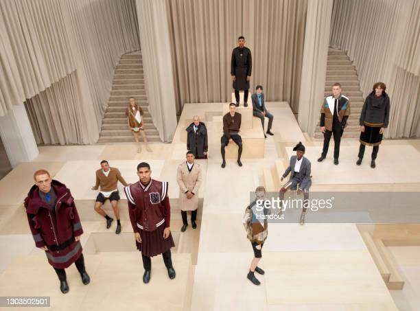 In this handout image provided by Burberry, models pose on the runway during the Burberry Autumn/Winter 2021 Menswear Presentation during LFW...