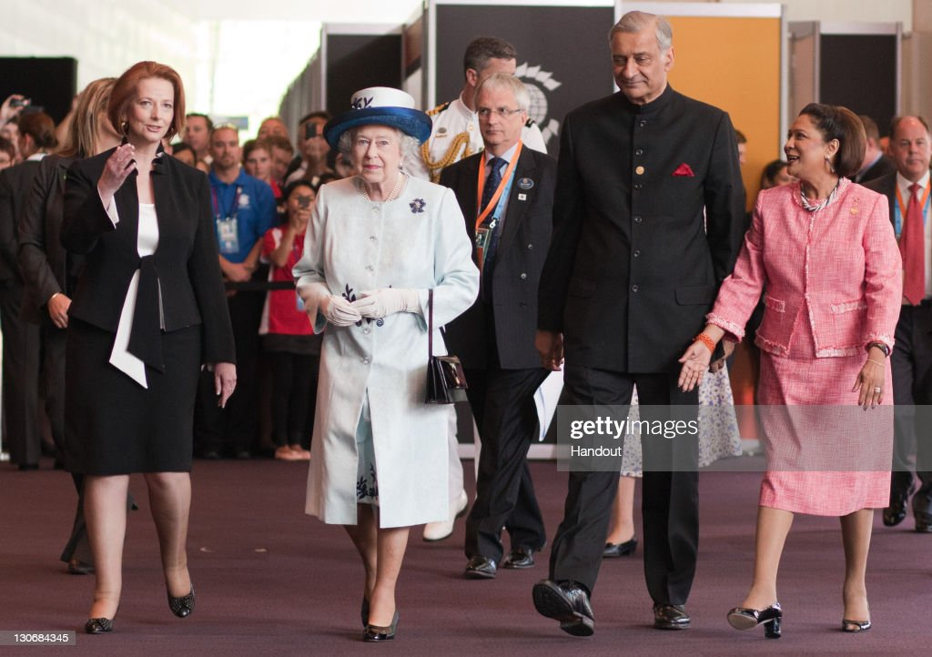 In this handout image provided by CHOGM, (L-R) Australian Prime Minister Julia Gillard, Queen Elizabeth II, Commonwealth Secretary-General, His Excellency Kamalesh Sharma, and Prime Minister of Trinidad and Tobago The Honourable Kamla Persad Bissessar arrive for CHOGM 2011 Opening Ceremony on October 28, 2011 in Perth, Australia. The three-day Commonwealth Heads of Government meeting takes place in Perth October 28 - 30.
