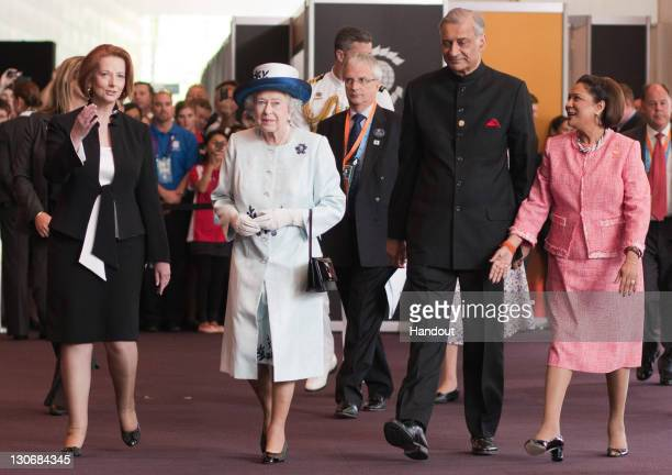 In this handout image provided by CHOGM Australian Prime Minister Julia Gillard Queen Elizabeth II Commonwealth SecretaryGeneral His Excellency...