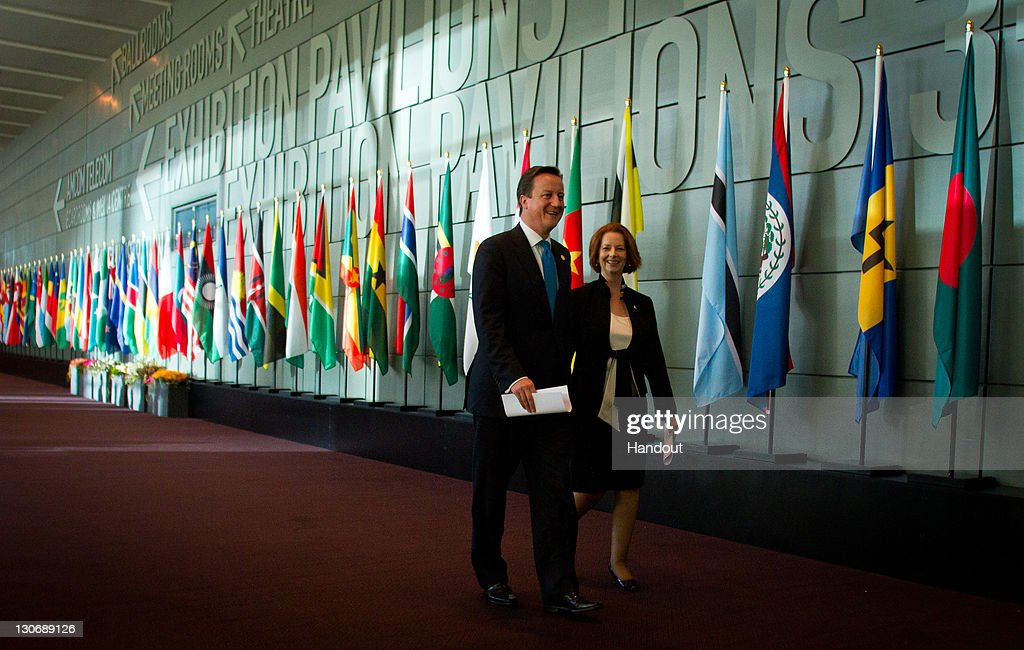 In this handout image provided by CHOGM, British Prime Minister David Cameron and Australian Prime Minister Julia Gillard walk together during the Commonwealth Heads of Government Meeting at the Perth Convention and Exhibition Centre on October 28, 2011 in Perth, Australia. Queen Elizabeth II opened the 54-nation summit today, following a 9-day tour of Australia. The three-day biennial gathering is chaired by Australian Prime Minister, Julia Gillard and concludes on October 30.