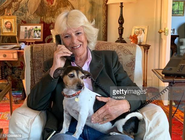 In this handout image provided by Clarence House Camilla Duchess of Cornwall speaks to Silver Line user Betty and the helpline's founder Dame Esther...