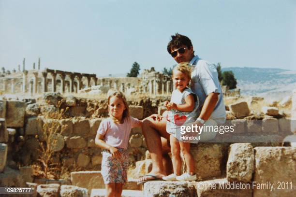 In this Handout Image provided by Clarence House www.officialroyalwedding2011.org, Kate Middleton with sister Pippa and Father Michael in Jerash,...