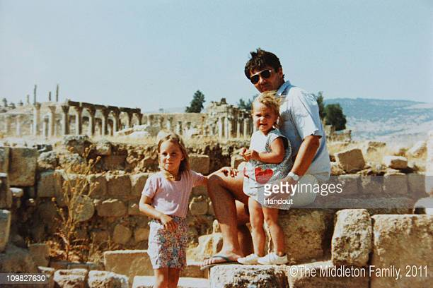 In this Handout Image provided by Clarence House wwwofficialroyalwedding2011org Kate Middleton with sister Pippa and Father Michael in Jerash Jordan...