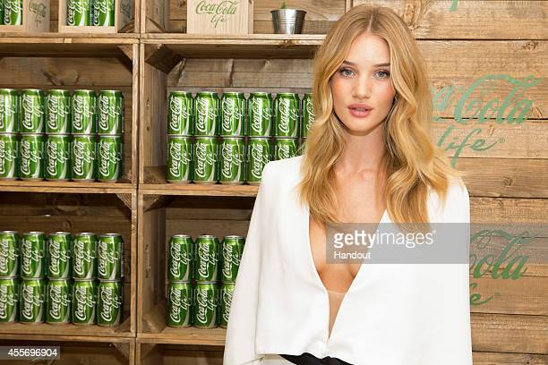 In this handout image provided by Coca Cola Rosie HuntingtonWhiteley launches CocaCola Life the new addition to the CocaCola family sweetened from...