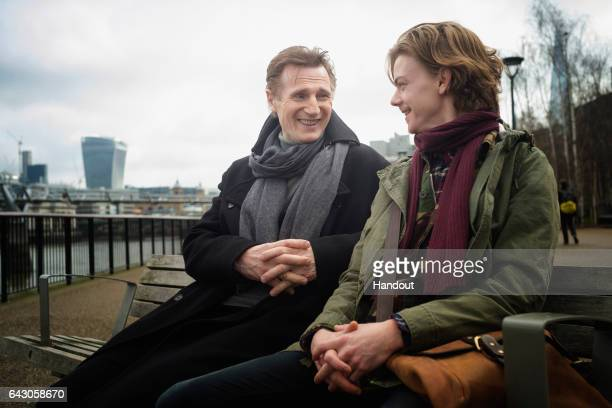In this handout image provided by Comic Relief Liam Neeson OBE as Daniel and Thomas BrodieSangster as Sam record a film for 'Red Nose Day Actually'...