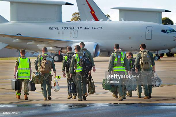In this handout image provided by Commonwealth of Australia air crew prepare to board the the E7A Wedgetail Airborne Early Warning and Control...