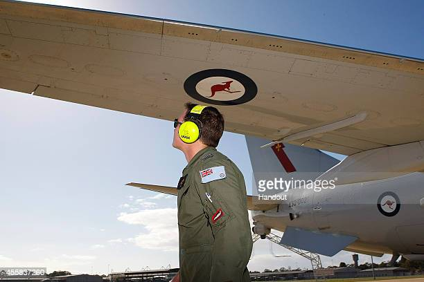 In this handout image provided by Commonwealth of Australia, air crew prepare the E-7A Wedgetail Airborne Early Warning and Control aircraft for...