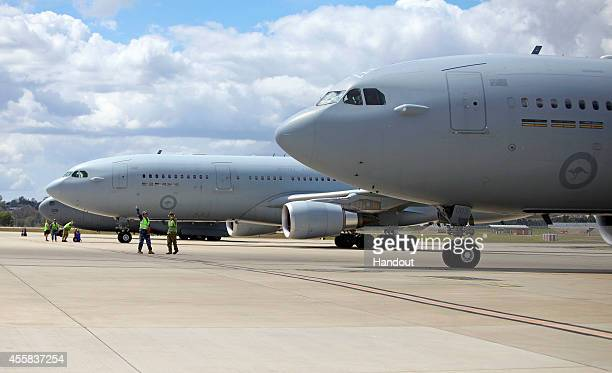 In this handout image provided by Commonwealth of Australia, aircraft are given the all clear to depart RAAF Base Amberley for the Middle East from...