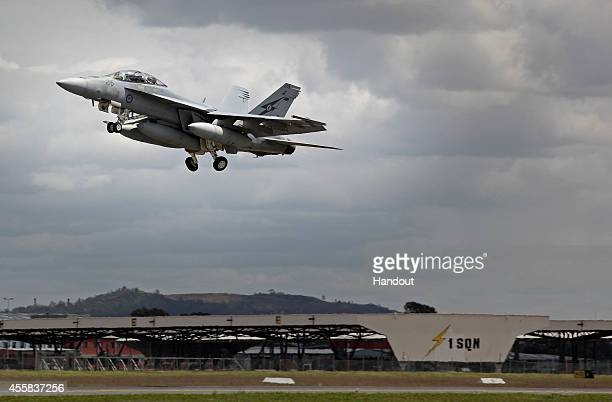 In this handout image provided by Commonwealth of Australia, an F/A-18F Super Hornet departs for the Middle East from RAAF Base Amberley on September...