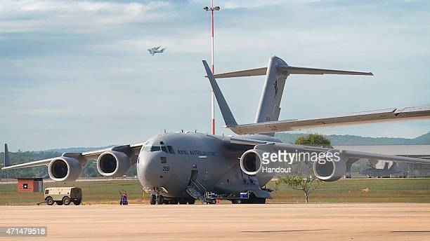 In this handout image provided by Commonwealth of Australia, Department of Defence, A No. 36 Squadron C-17A Globemaster prior to departure as the...