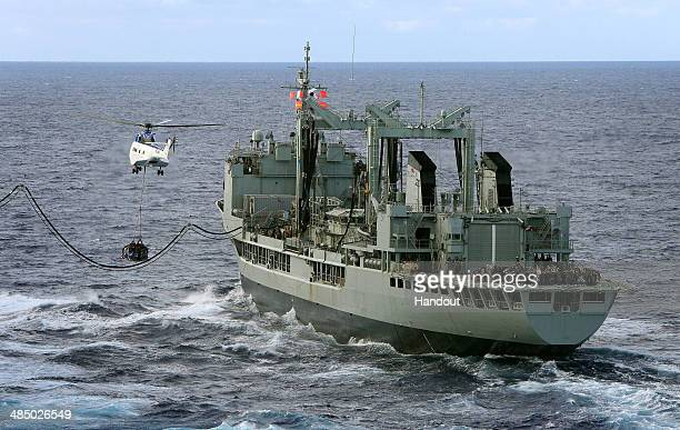 In this handout image provided by Commonwealth of Australia, Department of Defence, HMAS Success conducts a Replenishment at Sea with United States...