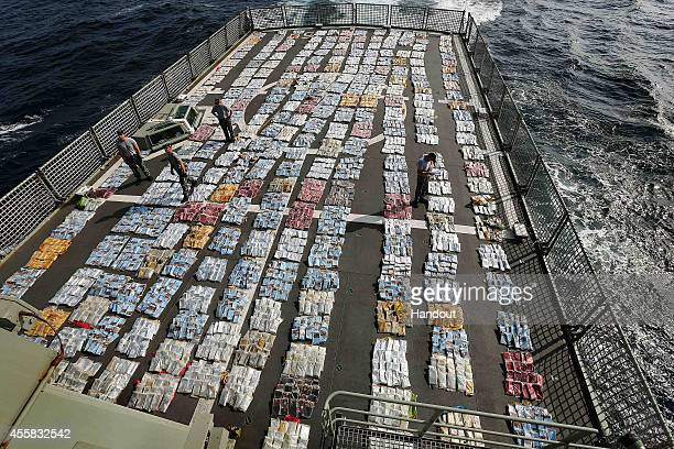 In this handout image provided by Commonwealth of Australia Department of Defence Members of HMAS Toowoomba account for and weigh 56 tonnes of...