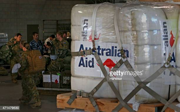 In this handout image provided by Commonwealth of Australia, Department of Defence, pallets of Australian Aid , are packed and prepared for delivery...