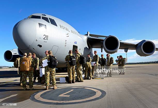 In this handout image provided by Commonwealth of Australia Department of Defence Australian Defence Force personnel prepare to board a No 36...