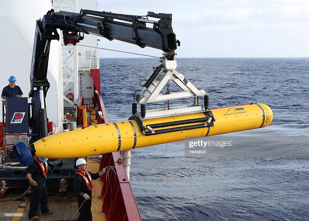 In this handout image provided by Commonwealth of Australia, Department of Defence, Phoenix Autonomous Underwater Vehicle (AUV) Bluefin-21 is craned over the side of Australian Defence Vessel Ocean Shield in the search for missing Malaysia Airlines flight MH 370 on April 14, 2014. Twenty-six nations have been involved in the search for Malaysia Airlines Flight MH370 since it disappeared more than a month ago.