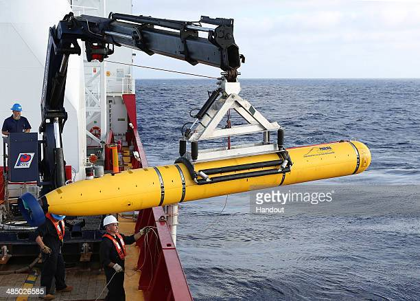In this handout image provided by Commonwealth of Australia, Department of Defence, Phoenix Autonomous Underwater Vehicle Bluefin-21 is craned over...