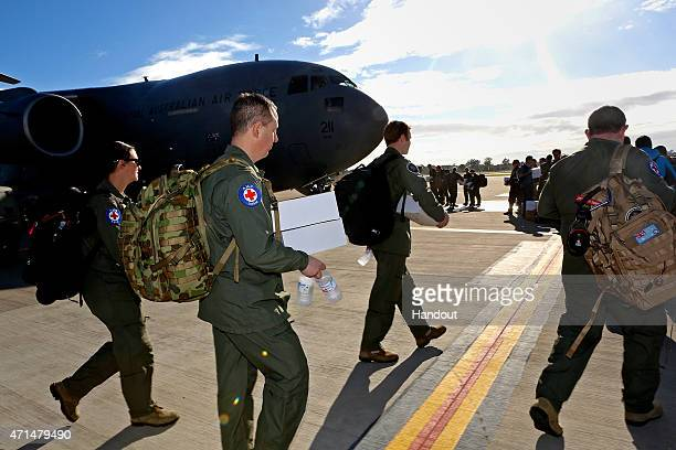 In this handout image provided by Commonwealth of Australia, Department of Defence, RAAF Amberley medical personnel and other Australian Defence...