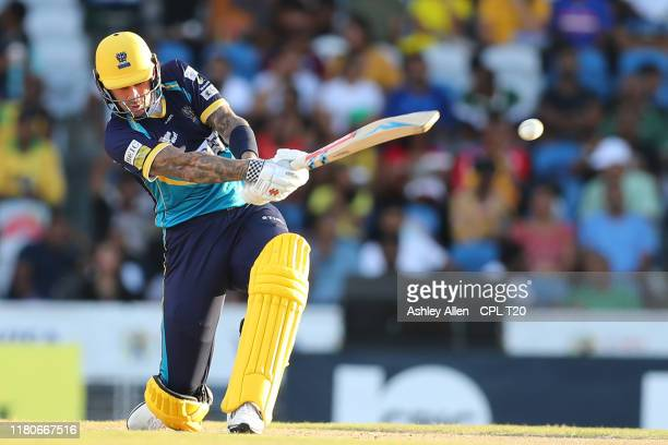 In this handout image provided by CPL T20 Alex Hales of Barbados Tridents hits six during the Hero Caribbean Premier League Final between Guyana...