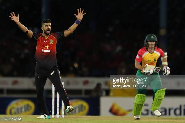 In this handout image provided by CPL T20 Ali Khan of Trinbago Knight Riders appeals successfully for the wicket of Luke Ronchi of Guyana Amazon...