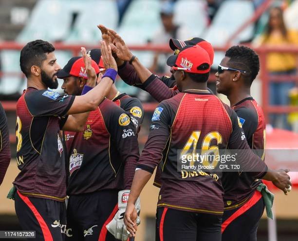 In this handout image provided by CPL T20 Ali Khan of Trinbago Knight Riders celebrates the dismissal of Mohammad Hafeez of St Kitts and Nevis...