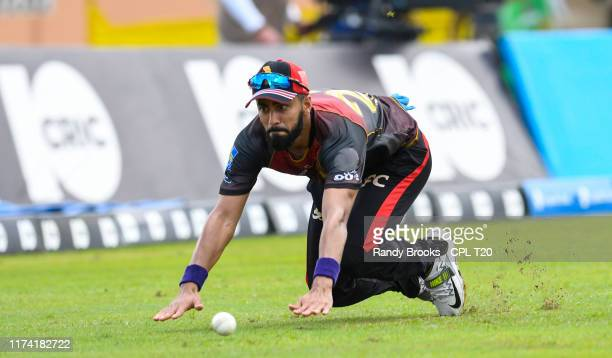In this handout image provided by CPL T20 Ali Khan of Trinbago Knight Riders fielding during the Hero Caribbean Premier League PlayOff match 31...