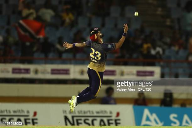 In this handout image provided by CPL T20 Ali Khan of Trinbago Knight Riders celebrates catching Rakeem Cornwall of the St Lucia Zouks during the...