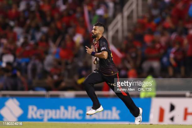 In this handout image provided by CPL T20 Ali Khan of Trinbago Knight Riders runs in to bowl during the Hero Caribbean Premier League match between...