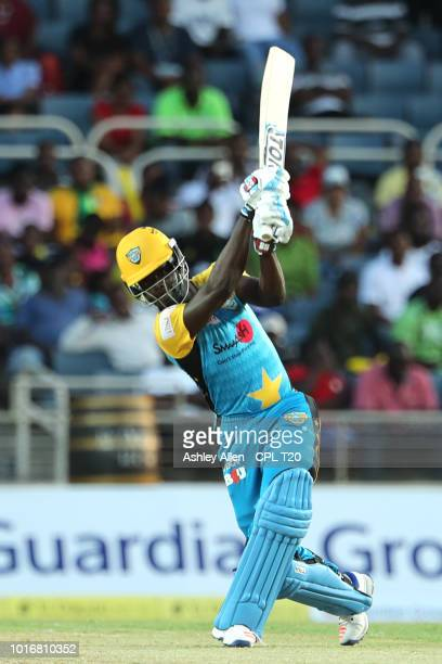 In this handout image provided by CPL T20 Andre Fletcher of St Lucia Stars hits a boundary during the Hero Caribbean Premier League match between...