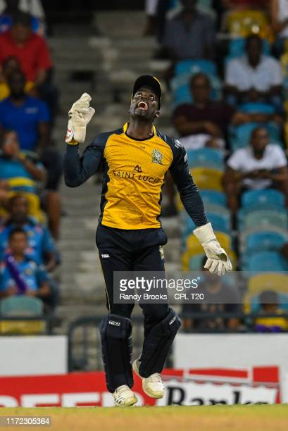 In this handout image provided by CPL T20 Andre Fletcher of St Lucia Zouks celebrates the dismissal of Jean Paul Duminy of Barbados Tridents during...