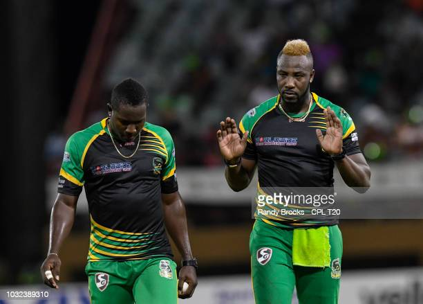 In this handout image provided by CPL T20 Andre Russell and Rovman Powell of Jamaica Tallawahs make bowling plans during the Hero Caribbean Premier...