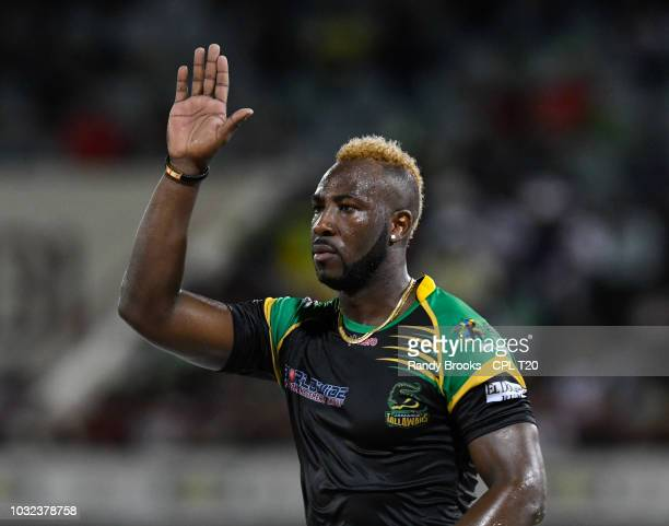 In this handout image provided by CPL T20 Andre Russell of Jamaica Tallawahs celebrates the dismissal of Fabian Allen of St Kitts Nevis Patriots...