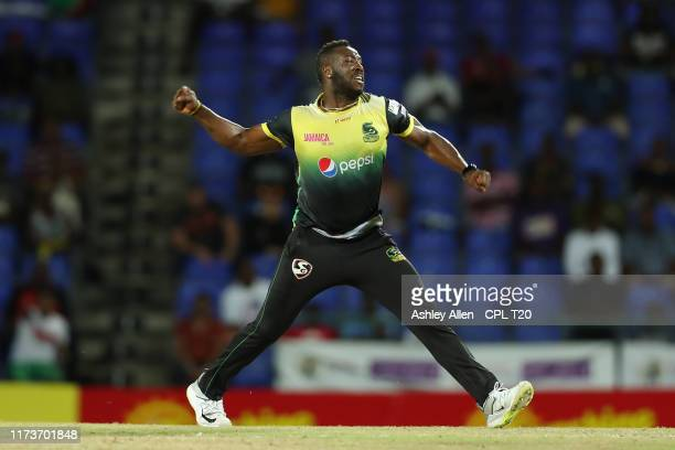 In this handout image provided by CPL T20, Andre Russell of Jamaica Tallawahs celebrates the wicket of Evin Lewis of St Kitts and Nevis Patriots...