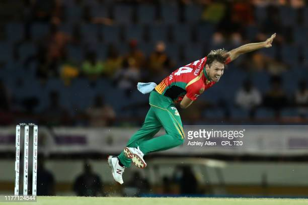 In this handout image provided by CPL T20 Ben Laughlin of Guyana Amazon Warriors bowls during the Hero Caribbean Premier League match between St...