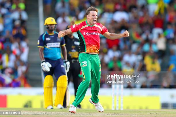 In this handout image provided by CPL T20 Ben Laughlin of Guyana Amazon Warriors celebrates during the Hero Caribbean Premier League Final between...