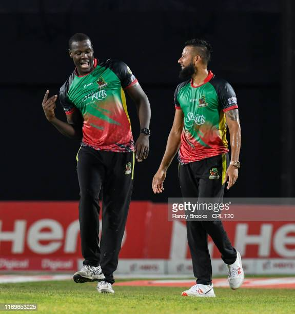 In this handout image provided by CPL T20, Carlos Brathwaite and Rayad Emrit of St Kitts and Nevis Patriots celebrate winning match 16 of the Hero...