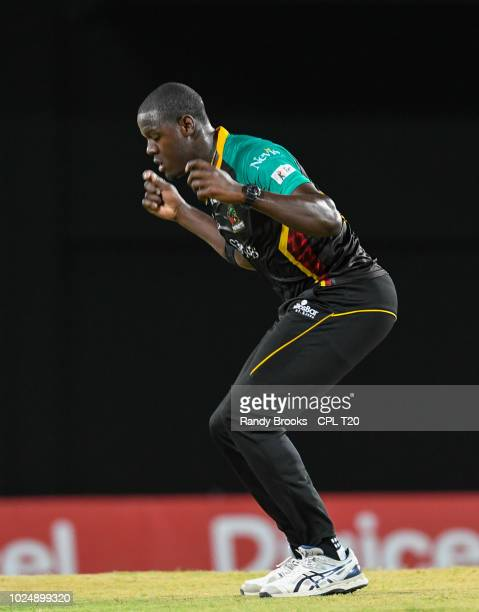 In this handout image provided by CPL T20 Carlos Brathwaite of St Kitts Nevis Patriots celebrates the dismissal of Shimron Hetmyer of Guyana Amazon...