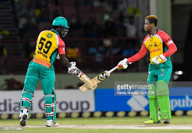 In this handout image provided by CPL T20 Chadwick Walton and Shimron Hetmyer of Guyana Amazon Warriors knock bats during the Hero Caribbean Premier...