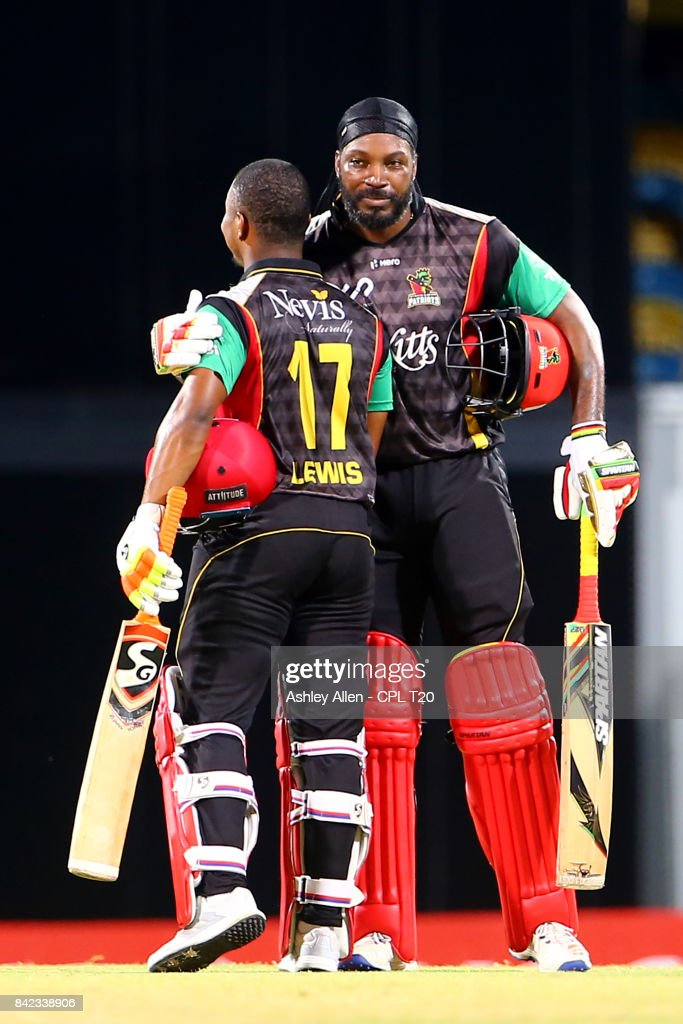 In this handout image provided by CPL T20, Chris Gayle (R) and Evin Lewis (L) of the St Kitts and Nevis Patriots during Match 30 of the 2017 Hero Caribbean Premier League between Barbados Tridents v St Kitts and Nevis Patriots at Kensington Oval on September 3, 2017 in Bridgetown, Barbados.