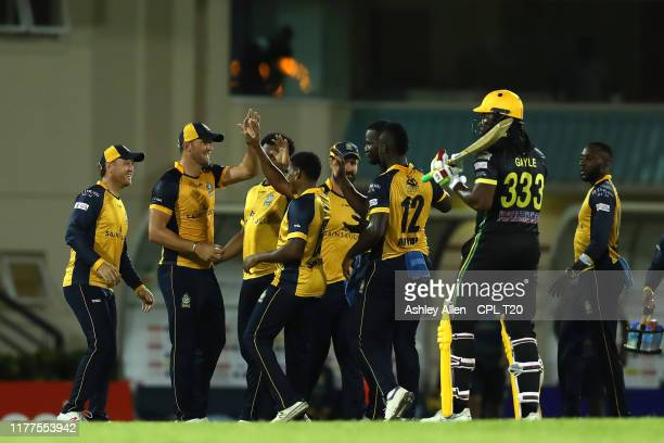 In this handout image provided by CPL T20 Chris Gayle of Jamaica Tallawahs is dismissed by Daren Sammy of St Lucia Zouks during the Hero Caribbean...