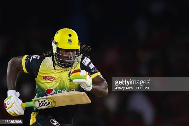 In this handout image provided by CPL T20 Chris Gayle of Jamaica Tallawahs runs between the wickets during the Hero Caribbean Premier League match...