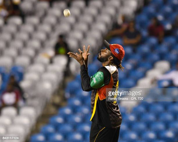 In this handout image provided by CPL T20 Chris Gayle of St Kitts Nevis Patriots takes the catch to dismiss Shadab Khan of Trinbago Knight Riders...