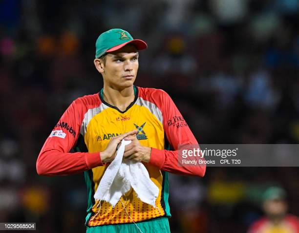 In this handout image provided by CPL T20 Chris Green of Guyana Amazon Warriors dries the ball during match 29 of the Hero Caribbean Premier League...