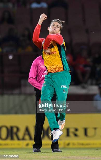 In this handout image provided by CPL T20 Chris Green of Guyana Amazon Warriors bowling during the Hero Caribbean Premier League PlayOff match 31...