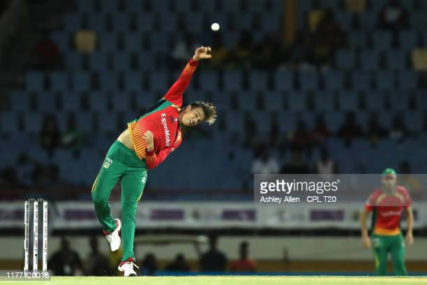 In this handout image provided by CPL T20 Chris Green of Guyana Amazon Warriors bowls during the Hero Caribbean Premier League match between St Lucia...