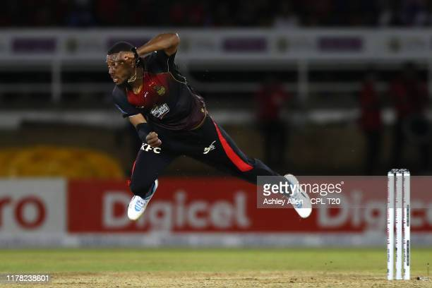 In this handout image provided by CPL T20, Chris Jordan of Trinbago Knight Riders bowls during the Hero Caribbean Premier League match between...