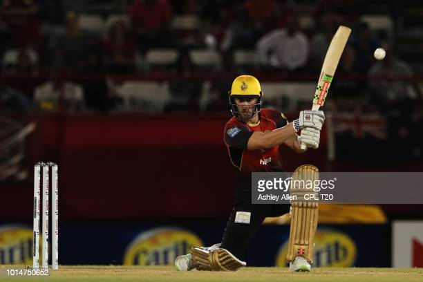 In this handout image provided by CPL T20 Chris Lynn of Trinbago Knight Riders hits the ball for four during the Hero Caribbean Premier League match...