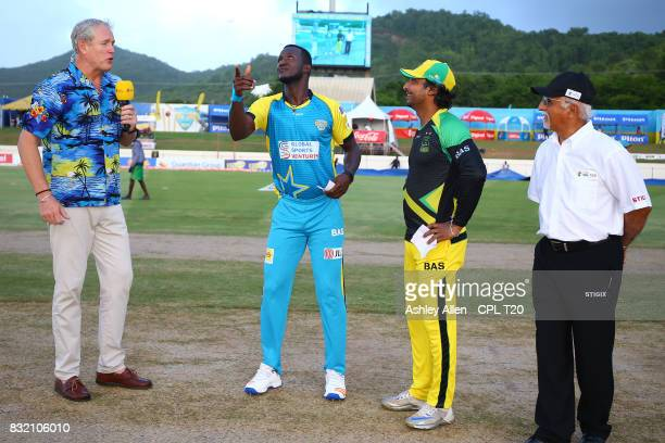 In this handout image provided by CPL T20 Daren Sammy captain of St Lucia Stars clicks the coin during the coin toss as Tom Moody Kumar Sangakarra...