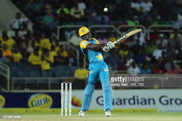 In this handout image provided by CPL T20 Daren Sammy of St Lucia Stars hits four during the Hero Caribbean Premier League match between Jamaica...