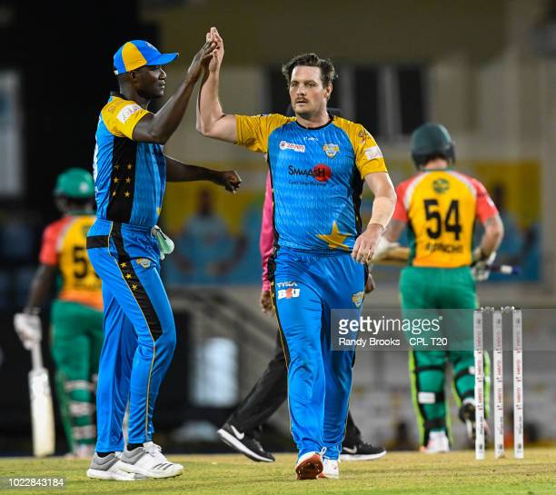 In this handout image provided by CPL T20 Darren Sammy and Mitchell McClenaghan of St Lucia Stars celebrate the dismissal of Luke Ronchi of Guyana...